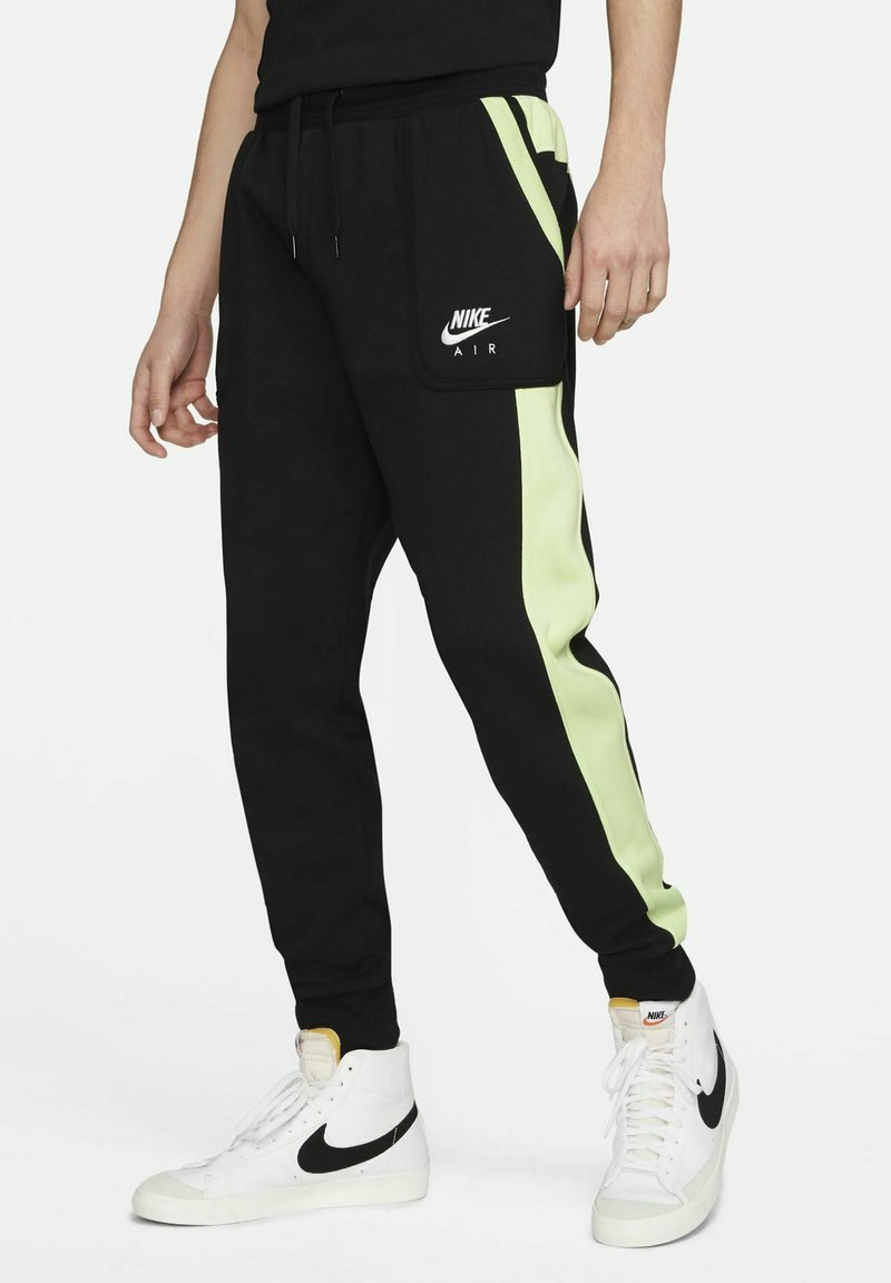 Nike Sportswear - AIR - Tracksuit bottoms - black/light liquid lime/white