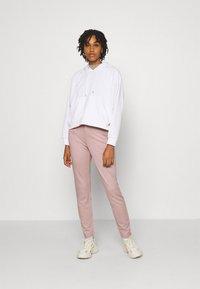 ONLY - ONLPOPTRASH LIFE STRIKE PANT - Trousers - pale mauve - 1