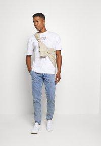 Jack & Jones - JJIMIKE JJUTILITY - Slim fit jeans - blue denim - 1