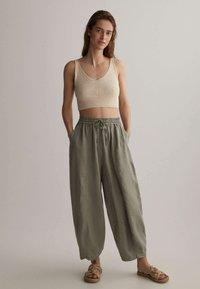 OYSHO - Trousers - khaki - 1