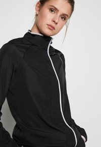 ONLY PLAY Tall - ONPPERFORMANCE RUN JACKET - Chaqueta de entrenamiento - black - 4
