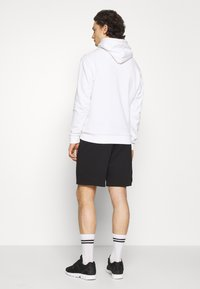 adidas Originals - ESSENTIAL UNISEX - Shorts - black