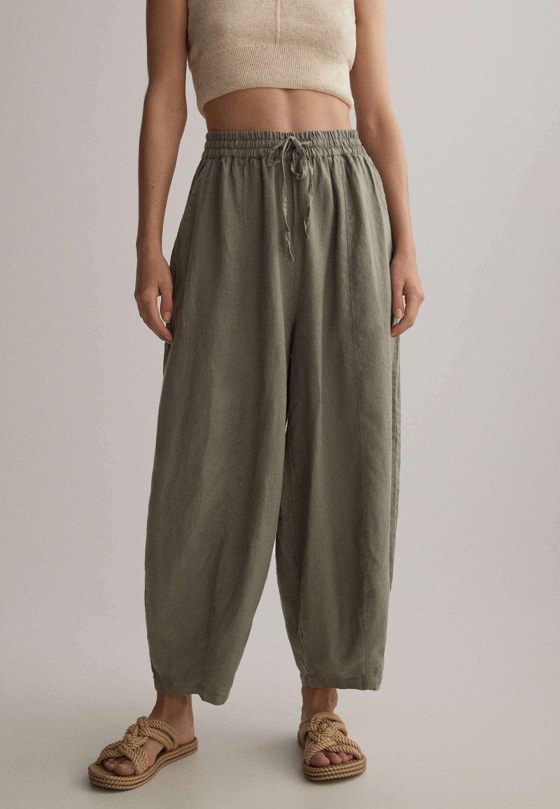 OYSHO - Trousers - khaki