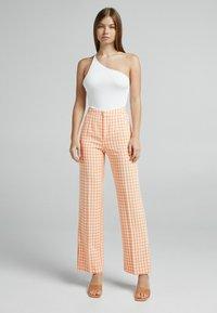 Bershka - Trousers - orange - 1