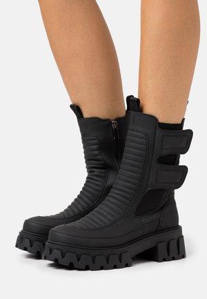 VEGAN VADER - Platform ankle boots - black