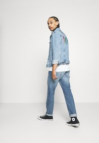 Levi's® - PRIDE THE TRUCKER JACKET - Denim jacket - blue denim - 1