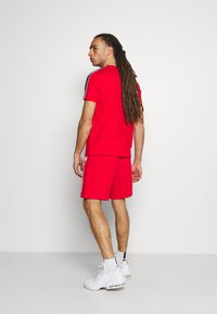 Champion - BERMUDA - Sports shorts - red - 2