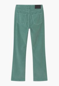 Grunt - FLARE - Trousers - soft moss - 1