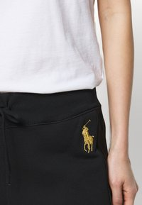 Polo Ralph Lauren - FEATHERWEIGHT - Tracksuit bottoms - black - 3