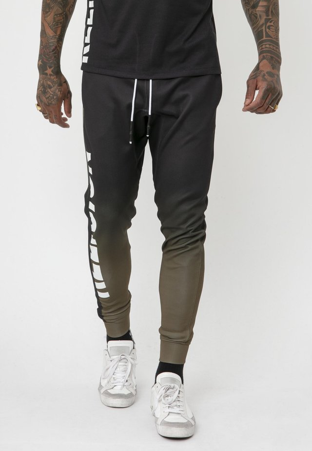 GRADIENT - Tracksuit bottoms - black/khaki