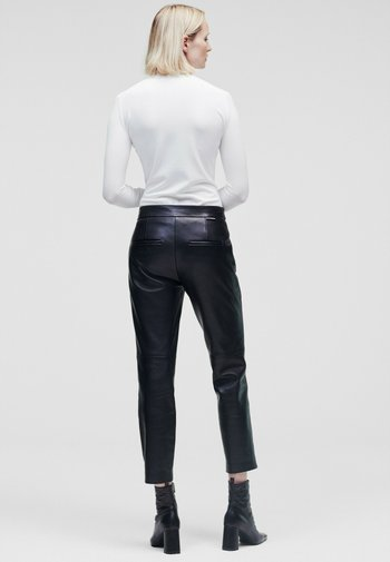 TAILORED - Leather trousers - black