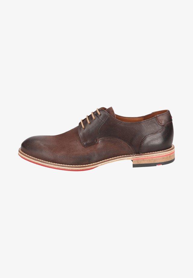 Sznurowane obuwie sportowe - t d moro