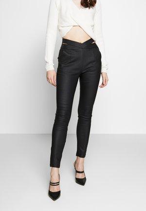 STEP UP PANT - Leggings - Trousers - black
