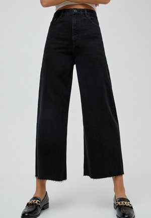 CULOTTE - Flared jeans - black