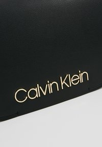 Calvin Klein - DRESSED UP SATCHEL - Handbag - black - 6