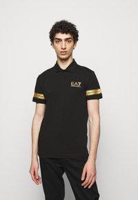 EA7 Emporio Armani - Polo shirt - black gold - 0