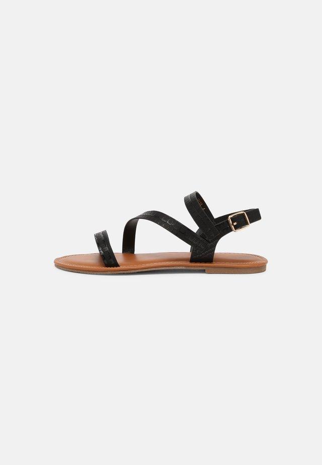 ARIYA - Sandales - black