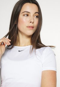 Nike Performance - ALL OVER - T-shirts - white - 3