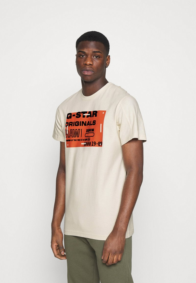 G-Star - FLOCK BADGE GRAPHIC - T-shirt med print - whitebait