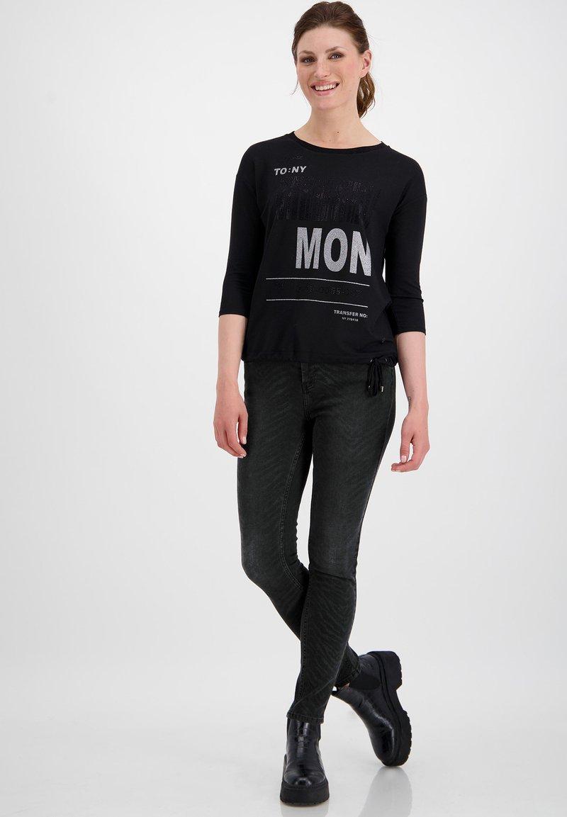 Monari - MIT ZEBRA-PRINT - Jeans Skinny Fit - schwarz