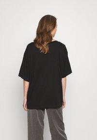 Weekday - REBECCA - T-shirts - black - 2
