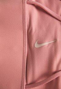 Nike Performance - LUXE BRA - Sport-BH mit mittlerer Stützkraft - rust pink/particle beige - 2