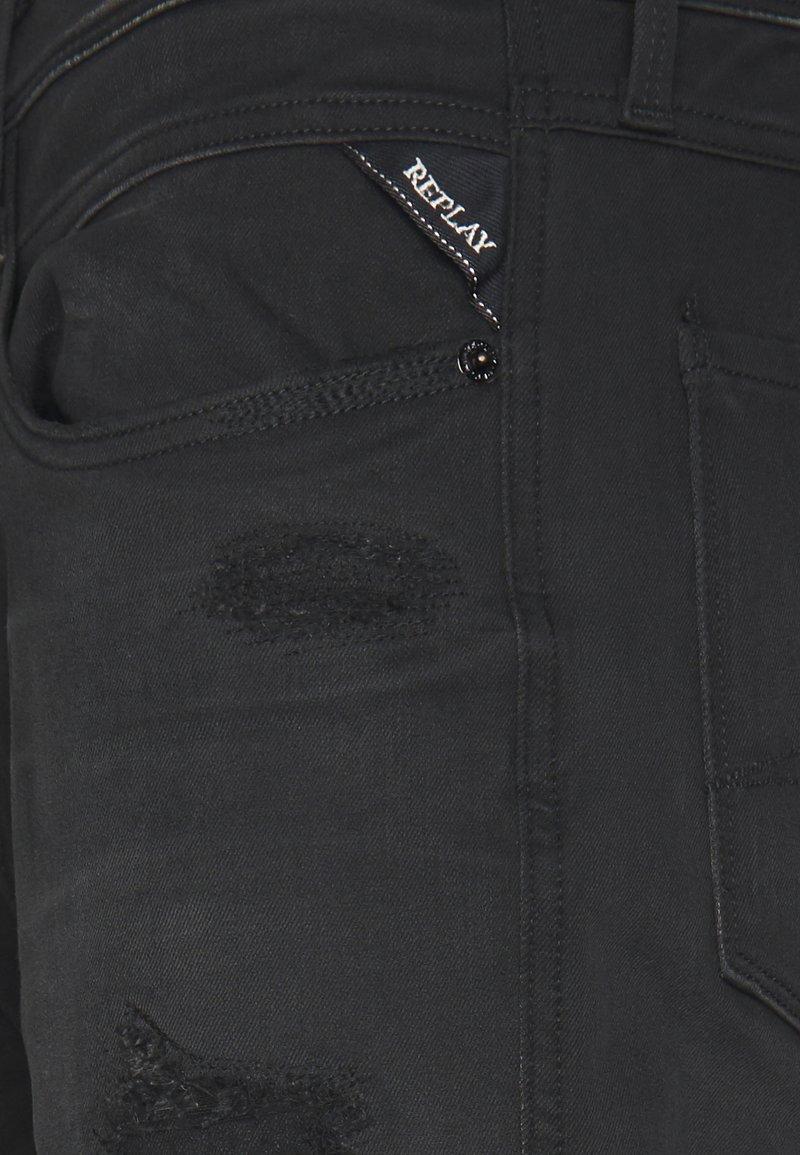 Replay ANBASS HYPERFLEX - Jeans Slim Fit - black denim nDn3i7