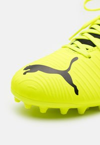 Puma - FUTURE Z 4.1 MG JR UNISEX - Moulded stud football boots - yellow alert/black/white - 5