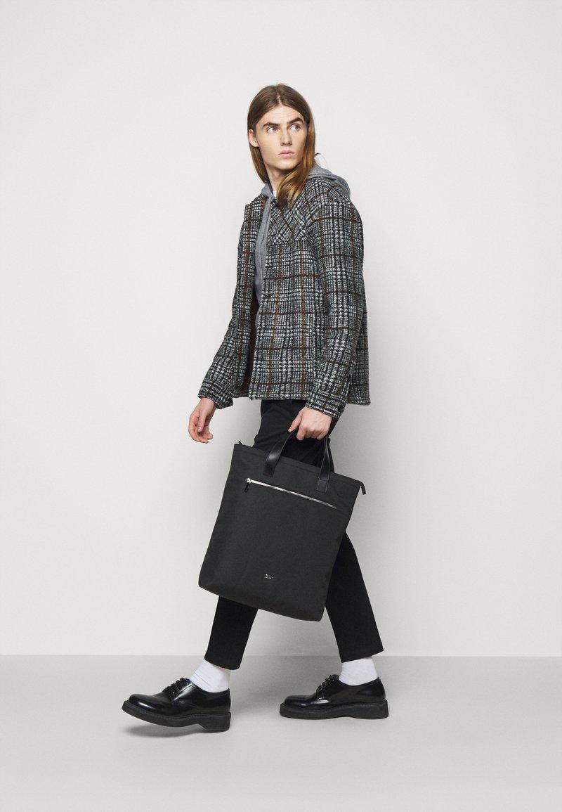 Tiger of Sweden - BARBETTE UNISEX - Shopping bag - black