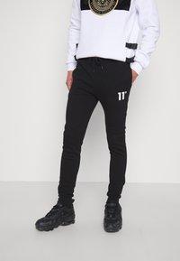 11 DEGREES - CORE SKINNY FIT - Teplákové kalhoty - black - 0
