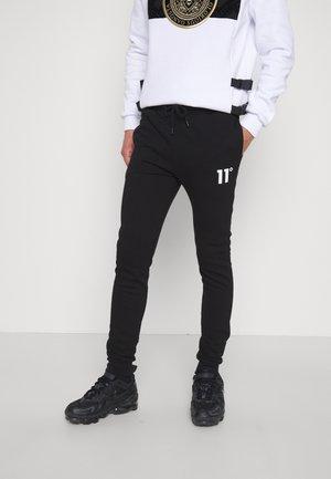 JOGGERS SKINNY FIT - Teplákové kalhoty - black
