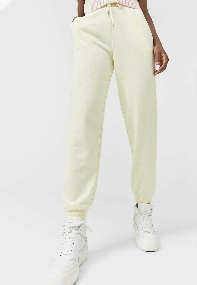 Teplákové kalhoty - yellow