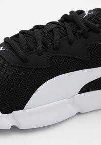 Puma - INTERFLEX RUNNER UNISEX - Sports shoes - black/white - 5