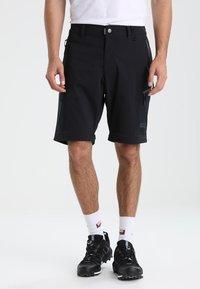 Jack Wolfskin - ACTIVATE LIGHT ZIP OFF - Outdoor trousers - black - 3