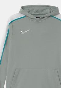 Nike Performance - HOODIE UNISEX - Sports shirt - light pumice/white - 2