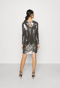 Vero Moda - VMCHARLI SHORT SEQUINS DRESS - Cocktail dress / Party dress - black/silver - 2