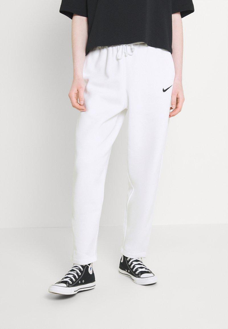 Nike Sportswear - Tracksuit bottoms - white/black
