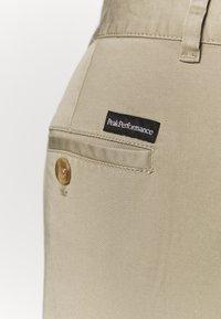 Peak Performance - MOMENT NARROW PANT - Kalhoty - true beige - 5