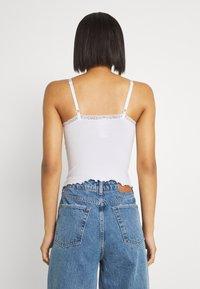 BDG Urban Outfitters - CROSS CAMI - Débardeur - white - 2