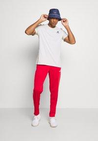 adidas Performance - 3 STRIPES SPORTS REGULAR PANTS - Teplákové kalhoty - scarlett/white - 1
