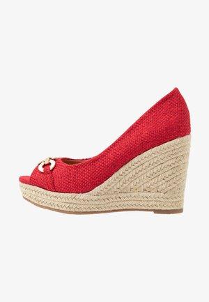 CARMELA - Peeptoe heels - red