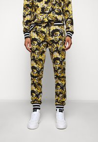 Versace Jeans Couture - FLEECE NEW LOGO - Tracksuit bottoms - nero - 0
