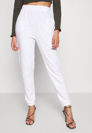 SIGNATURE BASIC - Tracksuit bottoms - white