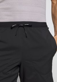 Nike Performance - FLEX STRIDE SHORT - Korte broeken - black/reflective silver - 3