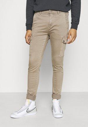 JAAN HYPERCARGO - Cargo trousers - sand