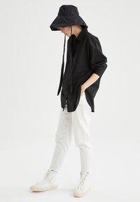 DeFacto - OVERSIZED - Button-down blouse - black - 1
