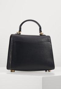Coach - TABBY TOP HANDLE - Handbag - black - 2