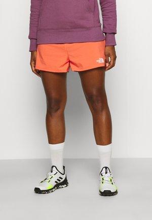 MOVMYNT SHORT - Sports shorts - emberglow orange
