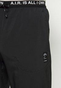 Nike Performance - PANT ART - Träningsbyxor - black - 4