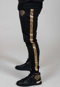 Ed Hardy - LOVE ED TRACK PANT - Tracksuit bottoms - black - 2